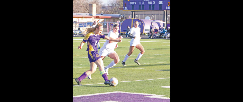 Outlook photo by Connor Waddingham                        Laurel sophomore Chloe Baumann strikes the ball into the box as she tries to set a teammate up with a goal against Park County.