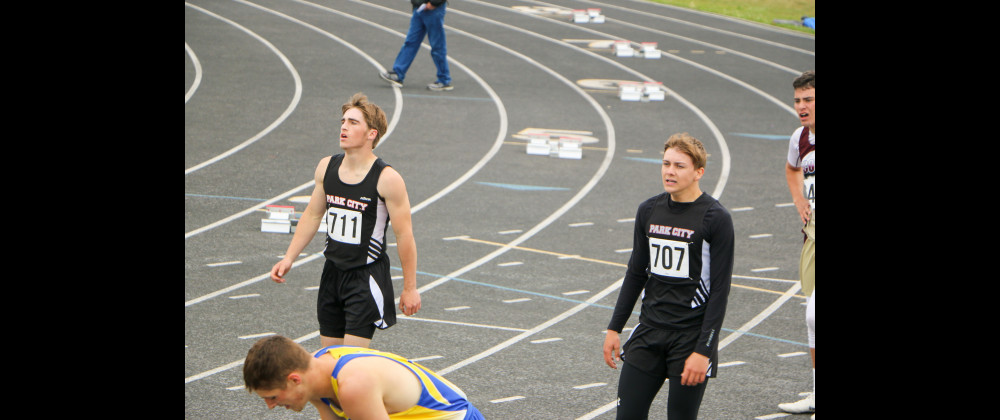 Outlook photo by Connor Waddingham                        Park City Panther sprinters Garrett Zimdars (right) and Corbin Downing (left) catching their breath after their 200 meter dash heat at divisionals last weekend. Both boys are qualified for state in multiple events.