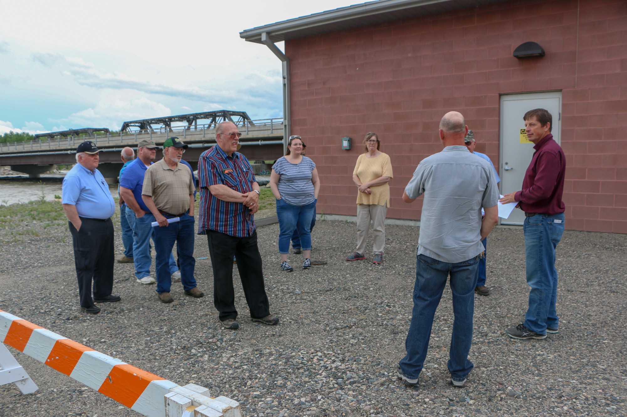 Kurt Markegardbrings the city council to the water treatment plant to show them the sediment basins .