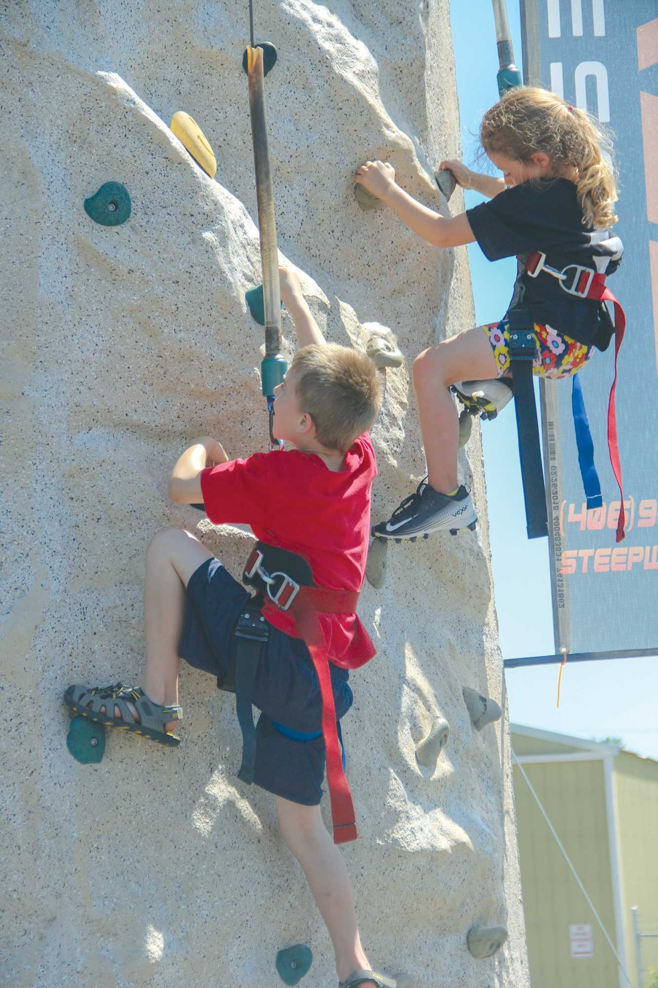 The rock climbing wall was a hit at Laurel Fire Safety Day on Saturday as youngsters lined up to scale 30–foot wall.