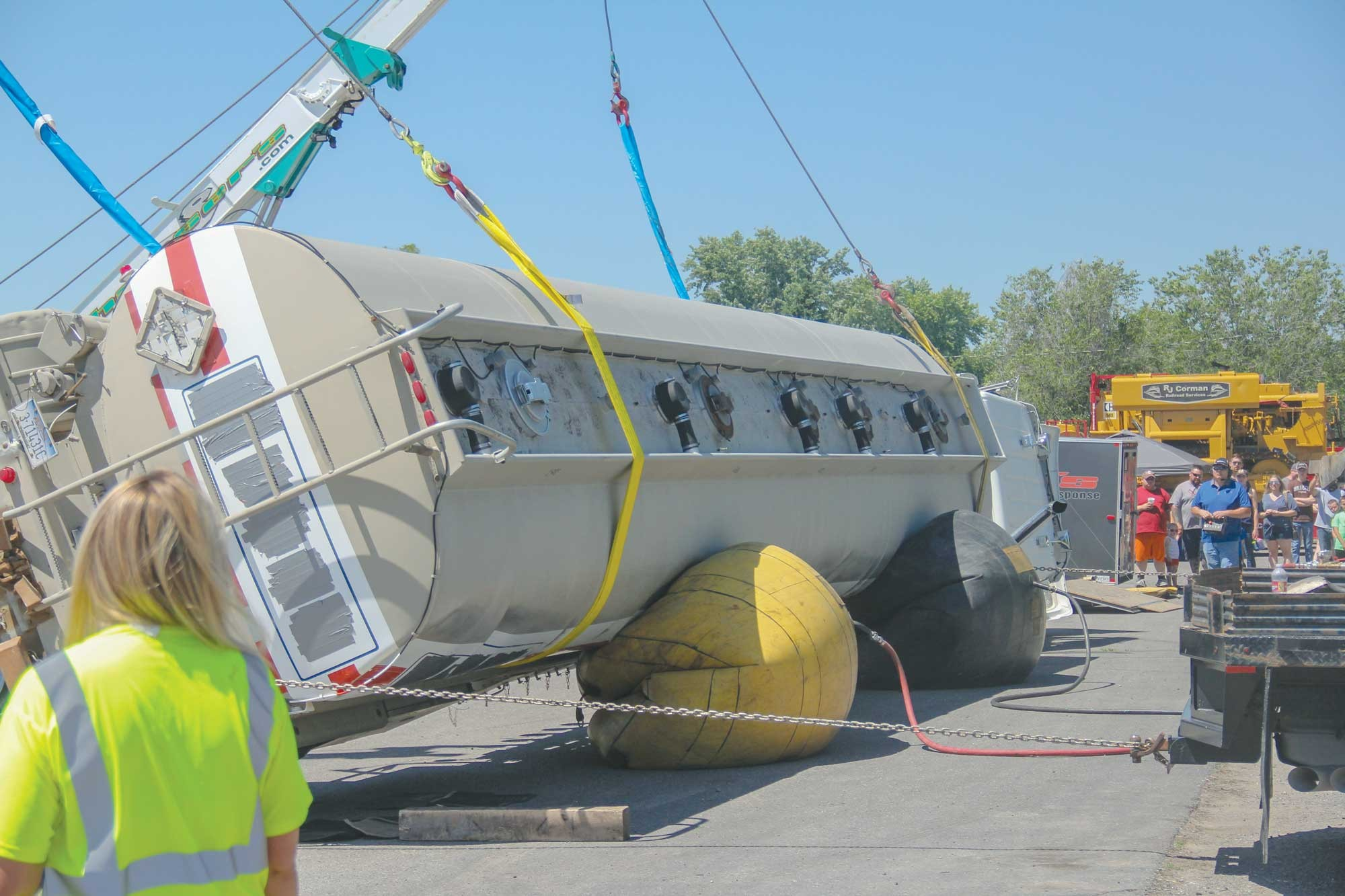 Airbags are used by Hansers' to lift an overturned tanker truck during Fire Safety Day.