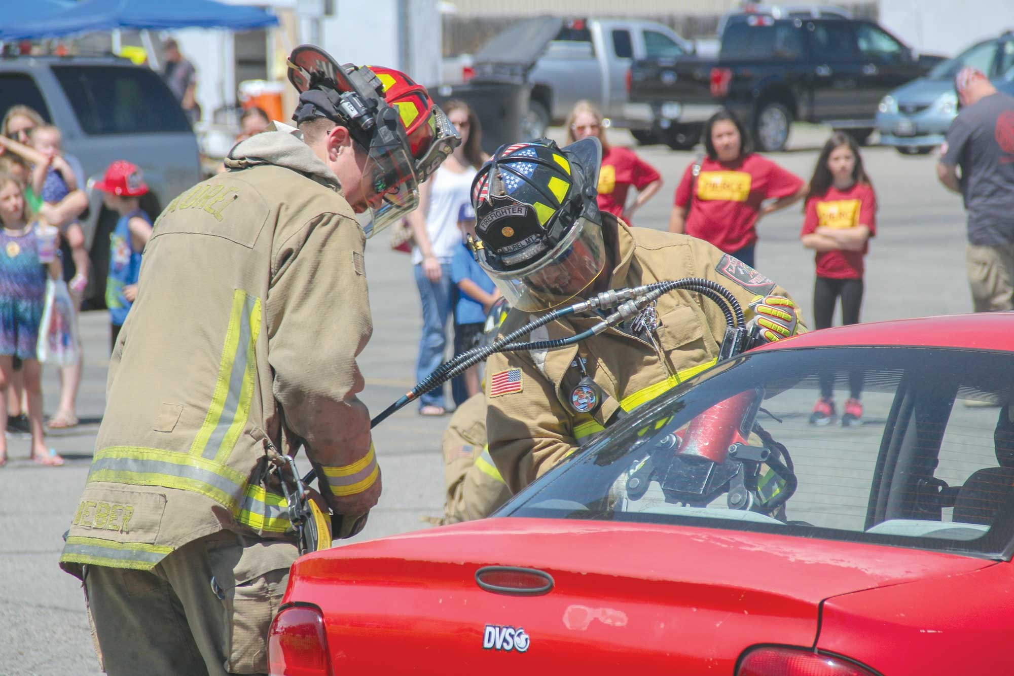 The LVFD is seen cutting off the rear driver–side door during Fire Safety Day on Saturday.