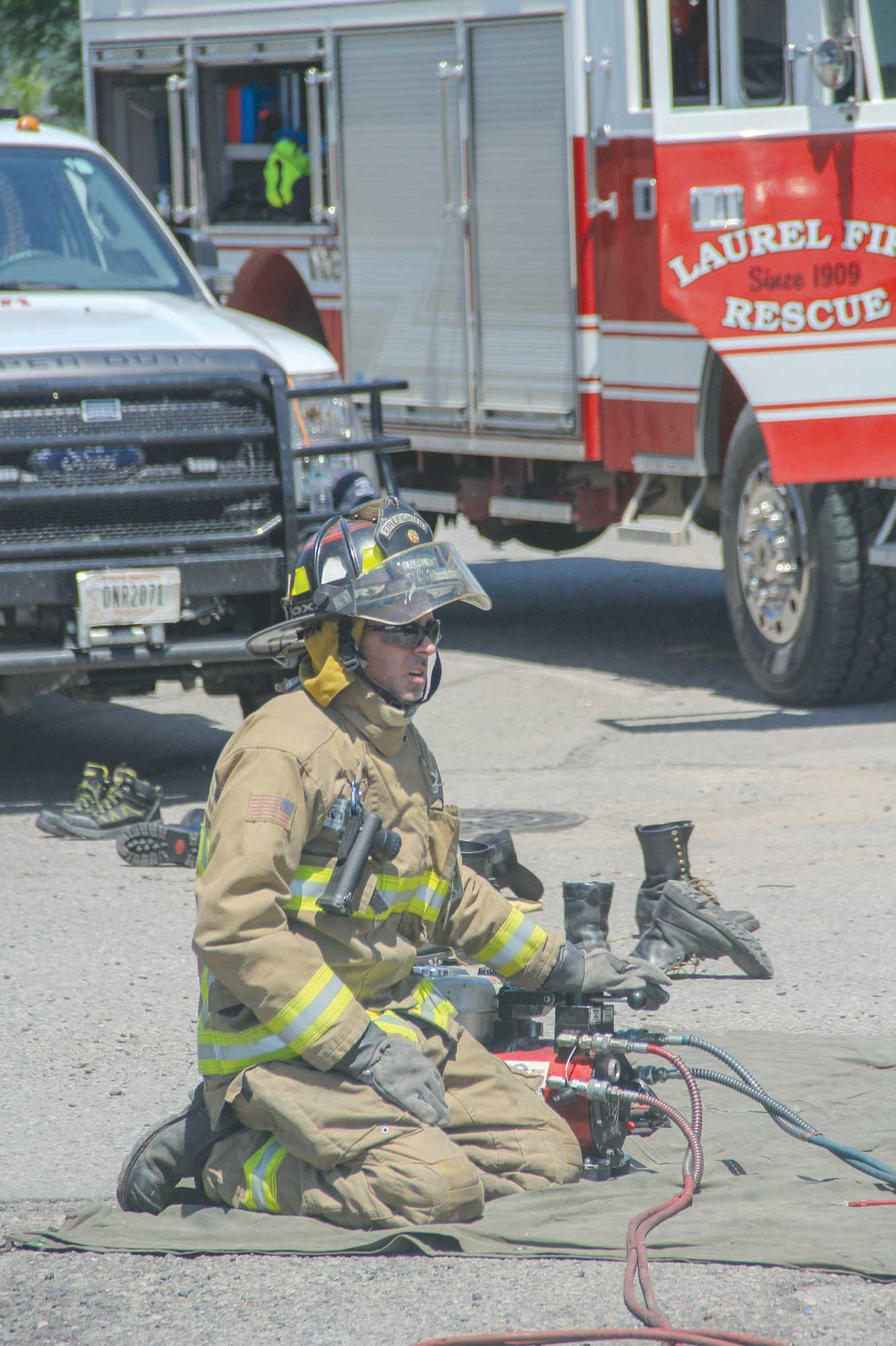 "LVFD Deputy Chief JW Hopper operates the power supply for the ""Jaws of Life"" during an extraction demonstration on Saturday."