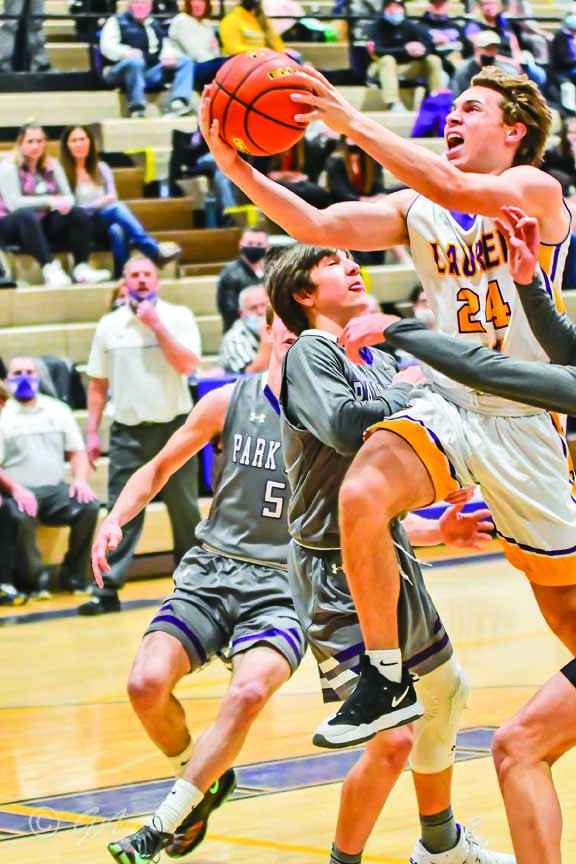 Photo courtesy of Gloria AllwinLocomotive Dalton Boehler goes for a lay-up in their game against Livingston. Laurel won 67-56.
