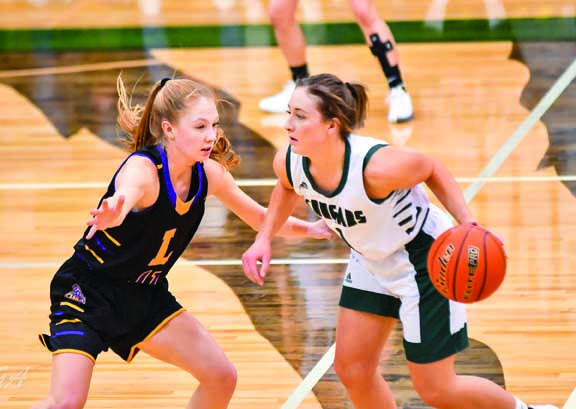 Photo courtesy of Gloria AllwinLady Locomotive Grace Timm guards a Columbus player during their game last Friday. Laurel lost the game by 1 point in double over time. Columbus won 41-40.